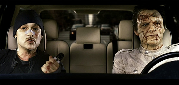 Punisher (2009): Loony Bin Jim and Jigsaw sit in car